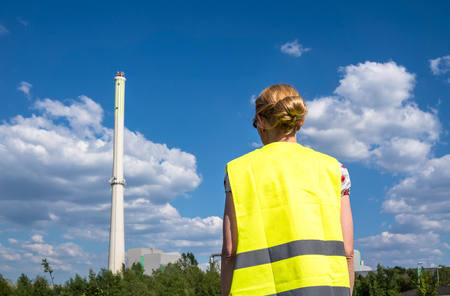 Lady observing the garbage incineration plant