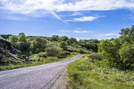 Single track road through the scottish highlands, uk