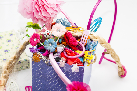 Colorful collection of girl stuff like barettes and hair clips Stock Photo