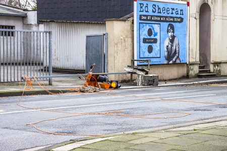 Essen / Germany - January 18 2018 : Temporary traffic lights overturned by the storm Friederike at the street crossing Schonnebeckhoefe, Hallo street and Saatbruch Street - Translation: The No 1 album with all hits Editorial