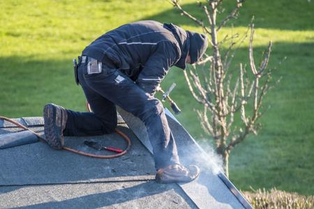 Roofer worker gas burner for maintenance