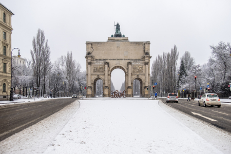 Munich / Germany - February 17 2018 : At the Victory Gate is standing a sculpture showing the letter love and from the back hate, build by the artist Mia Florentine Weiss