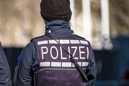 German Federal police officer woman protecting the city Stock Photo