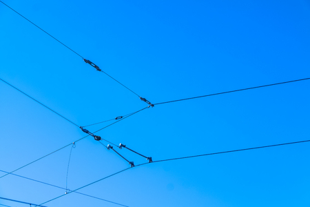 Railroad overhead lines against clear blue sky Contact wire