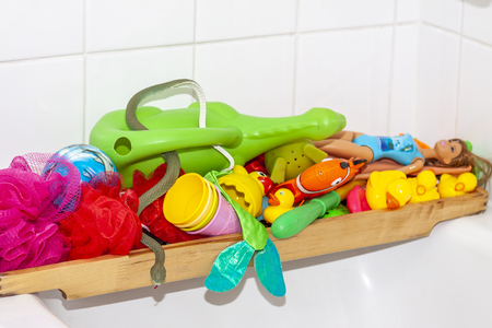 Variety of rubber bath ducks and toys