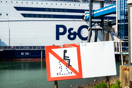 Rotterdam / Netherlands - April 19 2018 : Sign explaining that it is not allowed to sit on a bollard at the P & O Ferry terminal Editorial