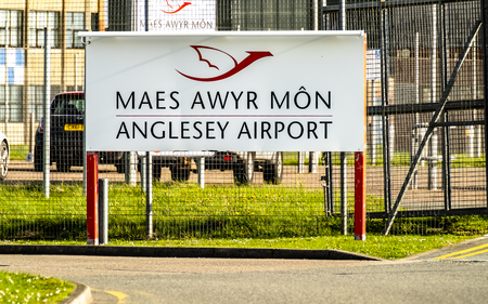 Anglesey / Wales - April 26 2018 : Sign welcoming to Anglesey Airport which is also an RAF airport with active Hawk T.2 airplanes operating Editorial