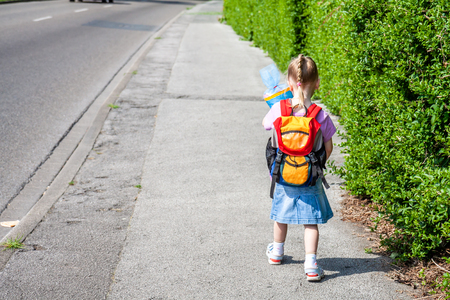 Little girl on her way to her first day of school