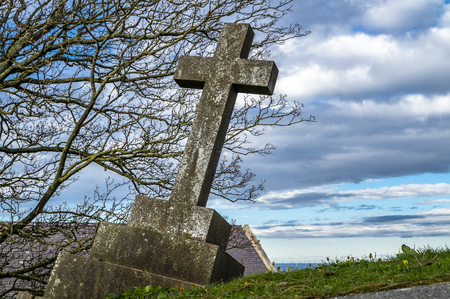 Dramatic grave standing at St Tudnos church and cemetery on the Great Orme at Llandudno, Wales, UK