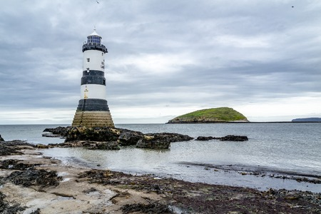 Penmon, Anglesey / Wales - April 23 2018: Penmon point lighthouse with puffin island - Wales - United Kingdom