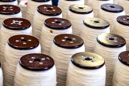 Traditional wool reels of the british waving and textile industry Stock fotó
