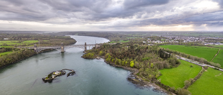 Robert Stephenson Britannia Bridge carries road and railway across the Menai Straits between, Snowdonia and Anglesey. Фото со стока