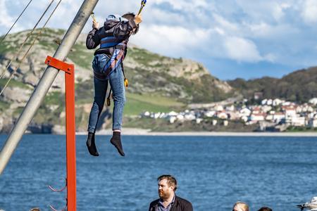Llandudno / Wales - April 23 2018 : Folks enjoying the Pier at the seaside resort of Llandudno, North Wales, United Kingdom Editorial
