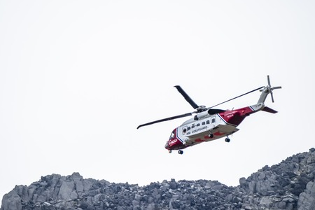 Ogwen Glen  Wales - April 29 2018 : British HM Coastguard helicopter Sikorsky S-92 operated by Bristow Helicopters conducting a rescue exercise at Ogwen Glen
