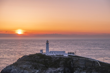 Sunset at south stack lighthouse on Anglesey in Wales - United Kingdom