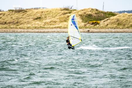 Caernarfon  Wales - May 01 2018 : Man windsurfing close to the town