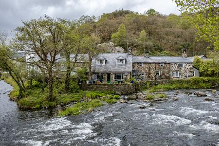 Glaslyn river running through Beddgelert in the heart of Smowdonia National Park in Gwynedd, Wales, UK