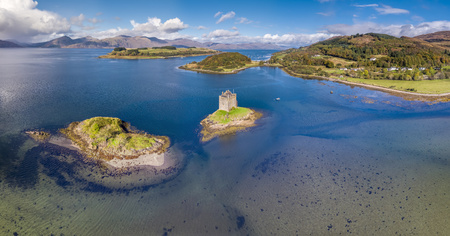 Aerial of the historic castle Stalker in Argyll in autumn, Scotland