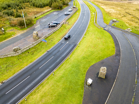 Aerial view of the border between Scotland and England with large stone and Scotland sign - United Kingdom Stock Photo
