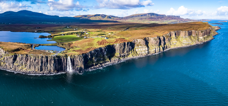 Aerial view of the dramatic coastline at the cliffs by Staffin with the famous Kilt Rock waterfall - Isle of Skye - Scotland Imagens