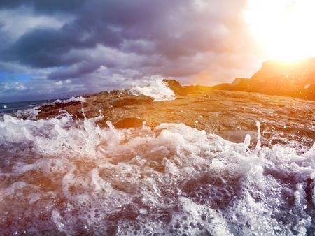 Blue Ocean Wave Crashing the coast at Sunrise Stock Photo