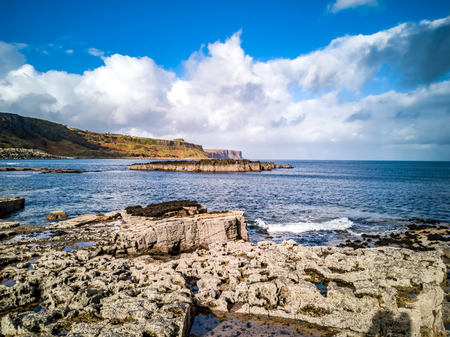 The coastline with the rare Dinosaur footprints of the sauropod-dominated tracksite from Rubha nam Brathairean, Brothers Point - Isle of Skye, Scotland Stock Photo