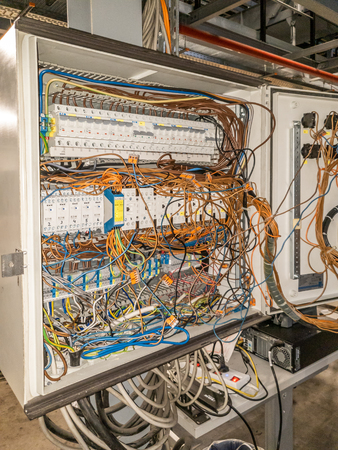 Herne / Germany - October 02 2018 : Cable chaos in electric control panel