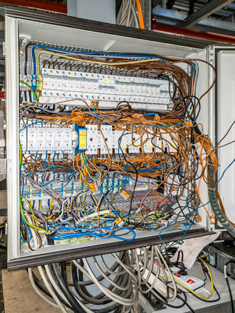 Herne / Germany - October 02 2018 : Cable chaos in electric control panel Editorial