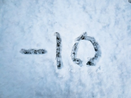 Temperature of -10 written in the freshly fallen snow