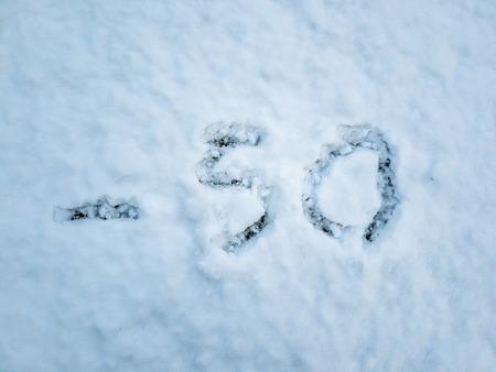 Temperature of -50 written in the freshly fallen snow