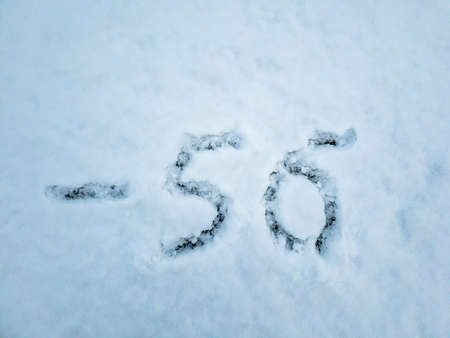 Temperature of -56 written in the freshly fallen snow