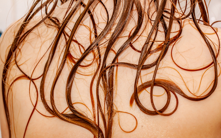 Close up of little girls wet hair in bath tube
