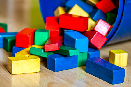 Colorful wooden building blocks on floor . Selective focus Banque d'images - 123199604
