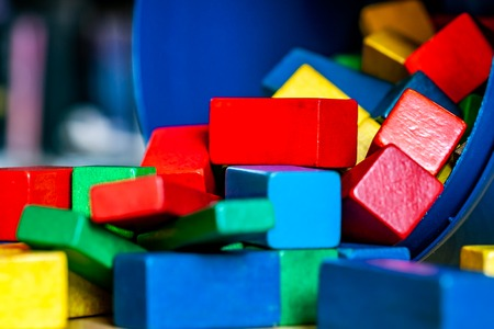 Colorful wooden building blocks on floor . Selective focus Banque d'images - 123199603
