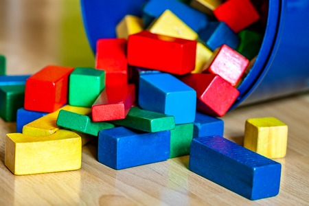 Colorful wooden building blocks on floor . Selective focus Banque d'images - 123199606