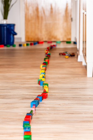 Track of dominoes on a wooden floor home