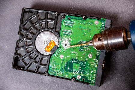 Concept of deleting big data by drilling a hole into the harddisk