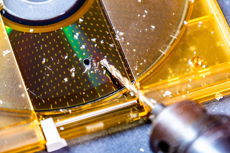 Concept of deleting big data by drilling a hole into the DVD RAM