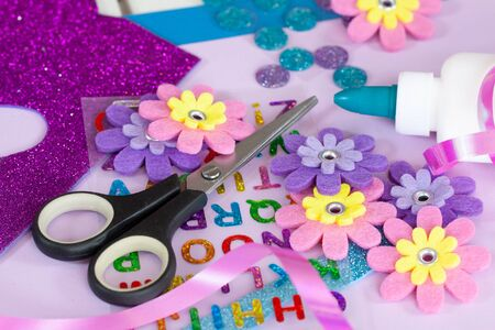 Making paper crafts for candy cone first day of school