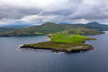 Mucross Head is a small peninsula about 10km west of Killybegs in County Donegal in north-west Ireland and contains a popular rock-climbing area, noted for its unusual horizontally layered structure Фото со стока