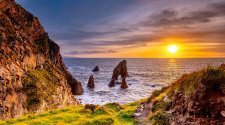 Crohy Head Sea Arch Breeches during sunset - County Donegal, Ireland Reklamní fotografie - 130685364