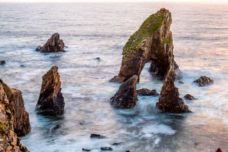 Long tme exposure of Crohy Head Sea Arch Breeches during sunset - County Donegal, Ireland