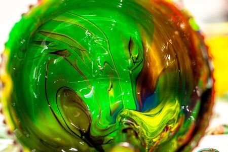 Close up of liquid artist colours on brush and pot