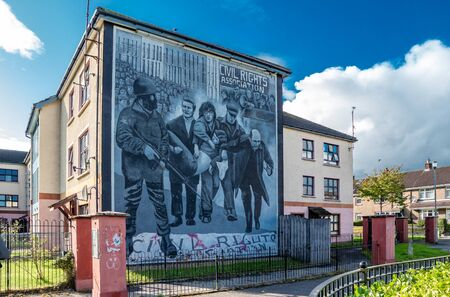 Derry, Londonderry / Northern Ireland - October 12 2019: This mural by unnamed bogside artists depicts the events of 30th January 1972 when the British Army opened fire on a civil rights demonstration Sajtókép