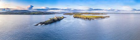 Aerial of the Rotten Island Lighthouse with Killybegs in background - County Donegal - Ireland. Stockfoto