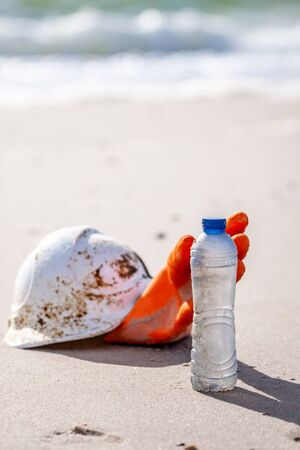 Concept of pollution, waste, disposal and plastic on the beach