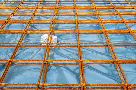 Metal reinforcement grid and wood frame for reinforced concrete basement construction 스톡 콘텐츠