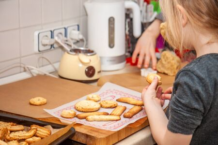 Little girl baking cookies in the kitchen at home