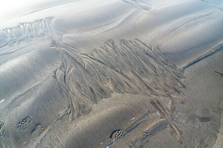 Sand surface with irregural wind pattern after storm
