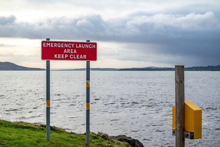 Sign Emergency launch Area Keep Clear in Buncrana - Ireland Reklamní fotografie